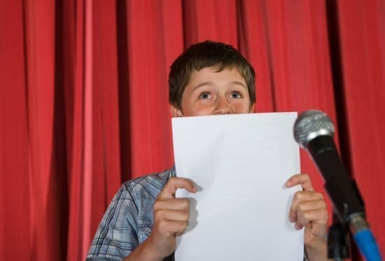 Image of a boy reading from a script.