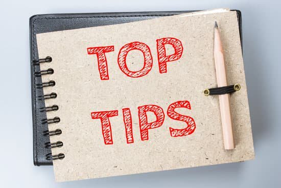 Image of a notebook with top tips written on it for the work from home tips section.