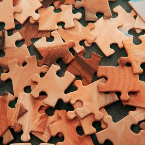 Image of puzzle pieces representing a diverse workforce.