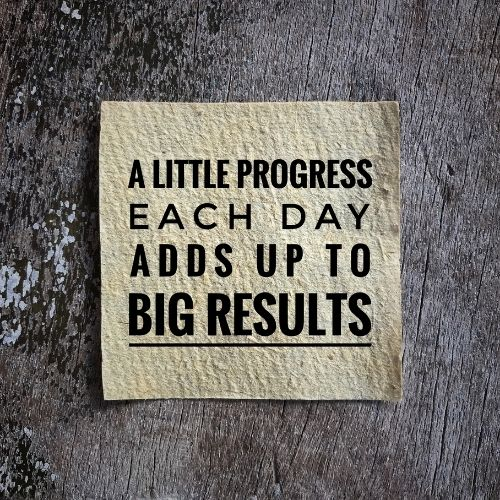 "Image of a note saying ""A little progress each day adds up to big results."""