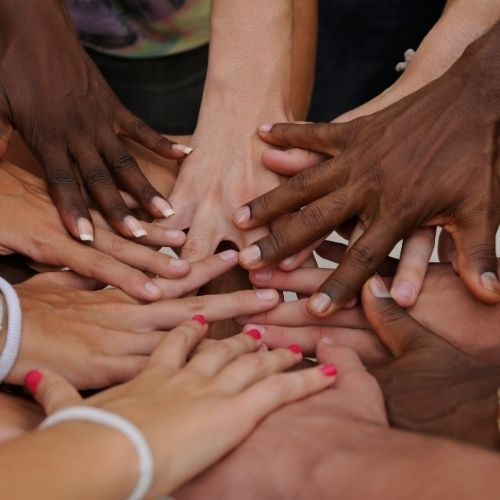Images of hands together from multiple colors and races for diversity section.