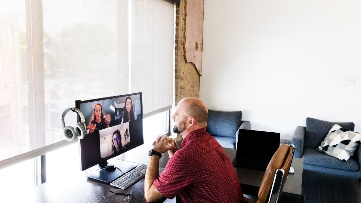 Image of a virtual team on a video chat for challenges of virtual teams article.