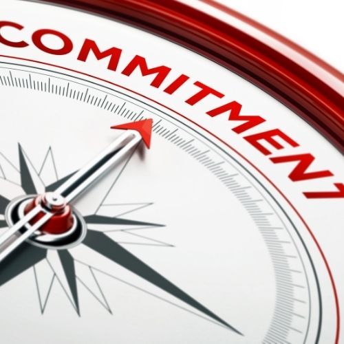 Image of a compass pointing to commitment.
