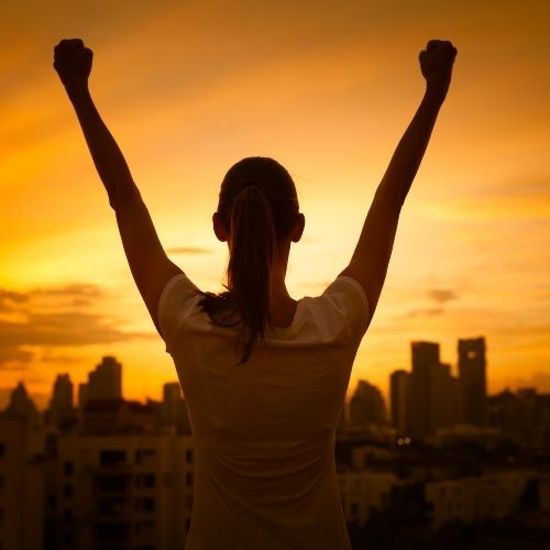 Image of woman celebrating success.