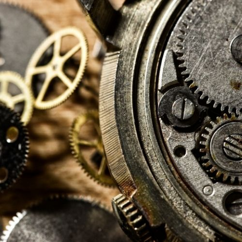 Image of gears representing the movement of processes. +