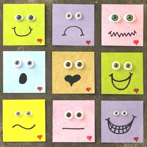 Image of sticky notes with different emotional faces drawn on them.