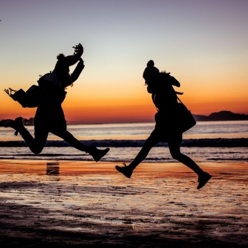 Image of two people jumping for personal growth and the areas of personal development.