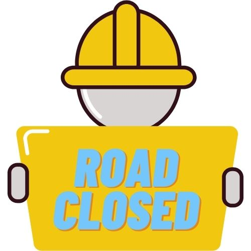 Image of a construction worker holding a sign saying road closed.