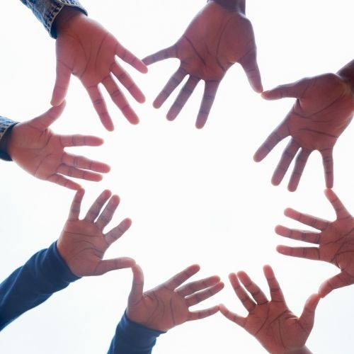 Image of hands in a circle representing circle of influence.
