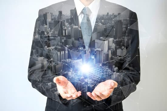 Image of a businessman holding a ball of light in his hands representing the vision leadership trait.