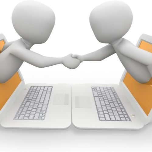Image of two people reaching through a computer shaking hands for digital meeting services section.