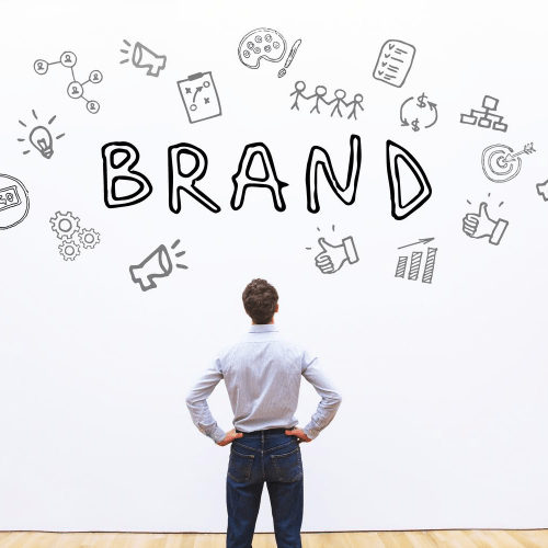 Image of a professional man looking at the word brand for building a personal brand.