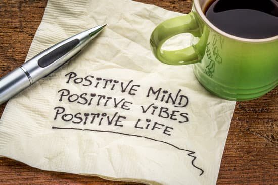 Image of a napkin with positive mind, positive vibes, and positive life written on it for the positivity quality of leadership.