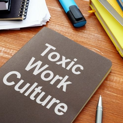 Image of a book with words toxic work culture for the toxic work environment causes section.