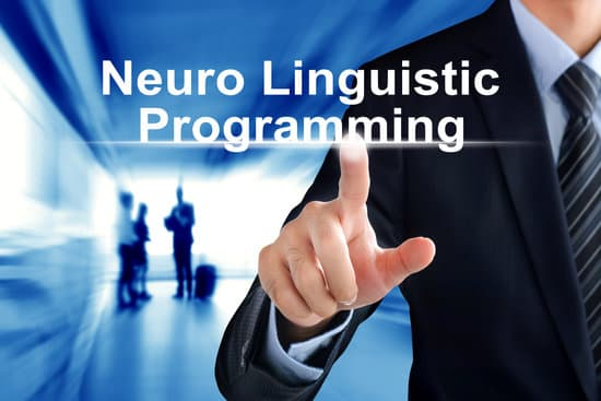 Man pointing at the words Neuro Linguistic Programming (NLP).