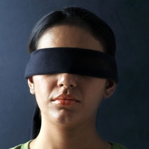 Image of a person blind folded for the Blind Retriever team building game.