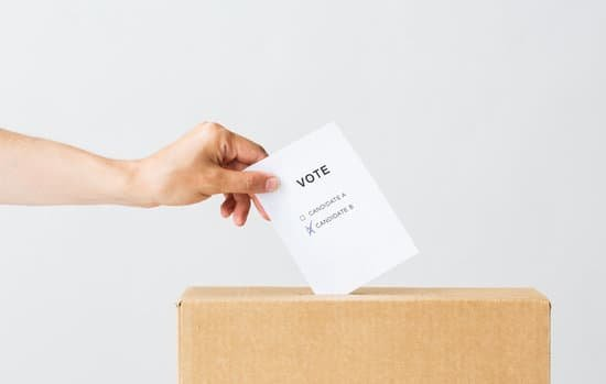 A person putting a vote into a box representing Democratic Leadership Style
