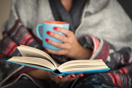 Image of a woman using her downtime to read a book and grow as a person.