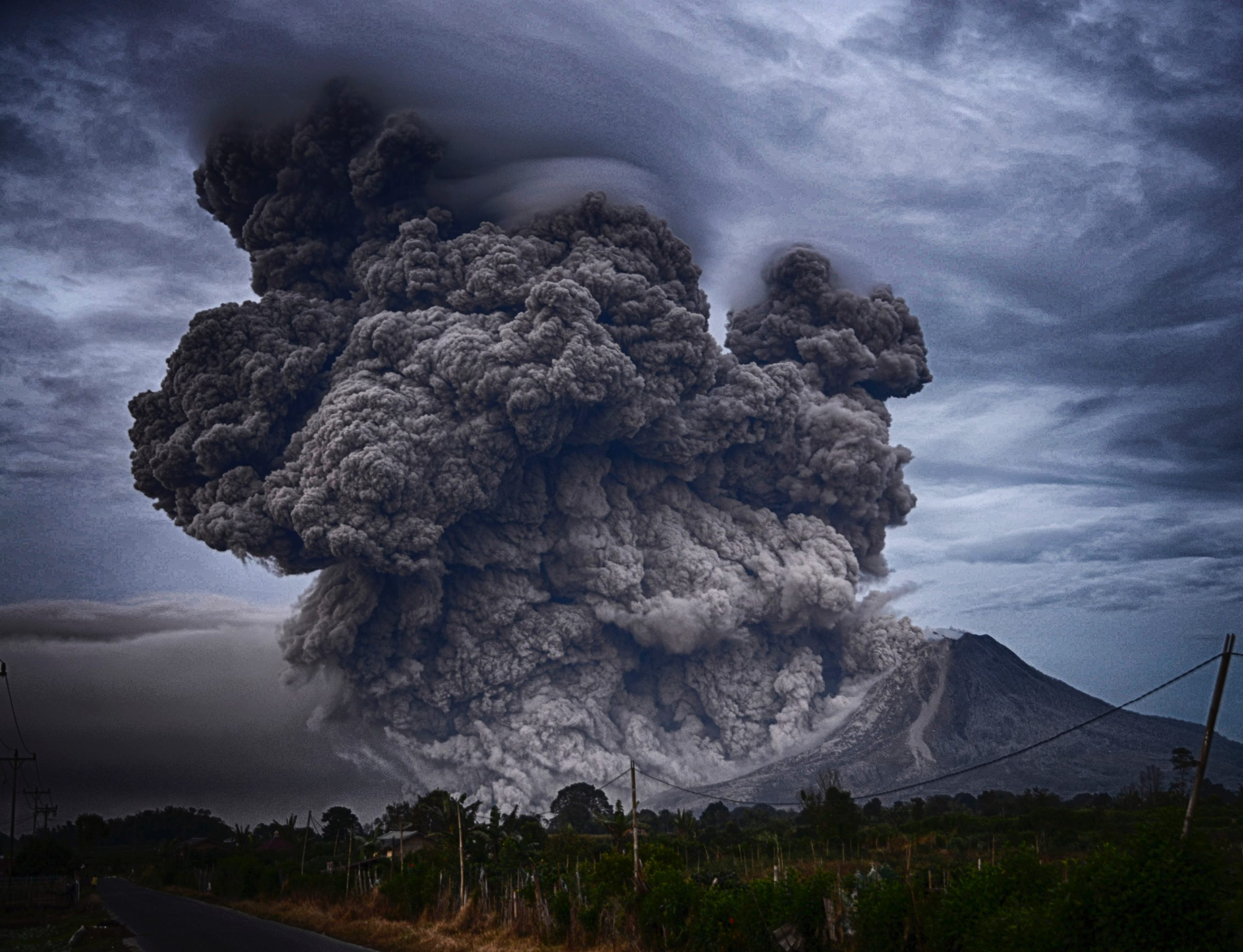 Image of exploding volcano representing a boss, leader, supervisor, manger blowing up at employees.