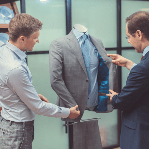 Image of two men looking at a suit for their professional image, personal image, image branding, personal branding.