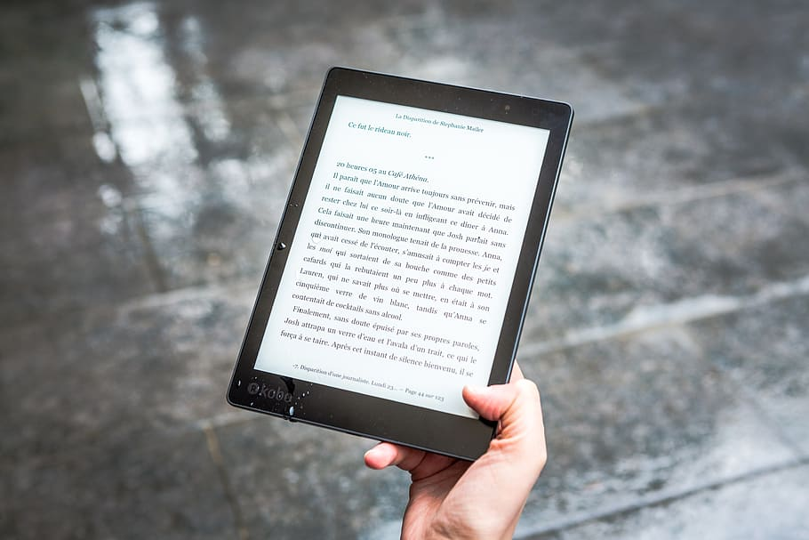 Image of a person reading an eBook for personal growth.